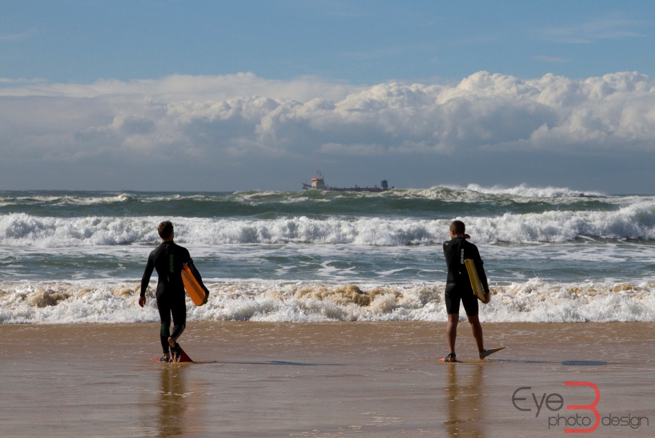 Bodyboarders entering the water